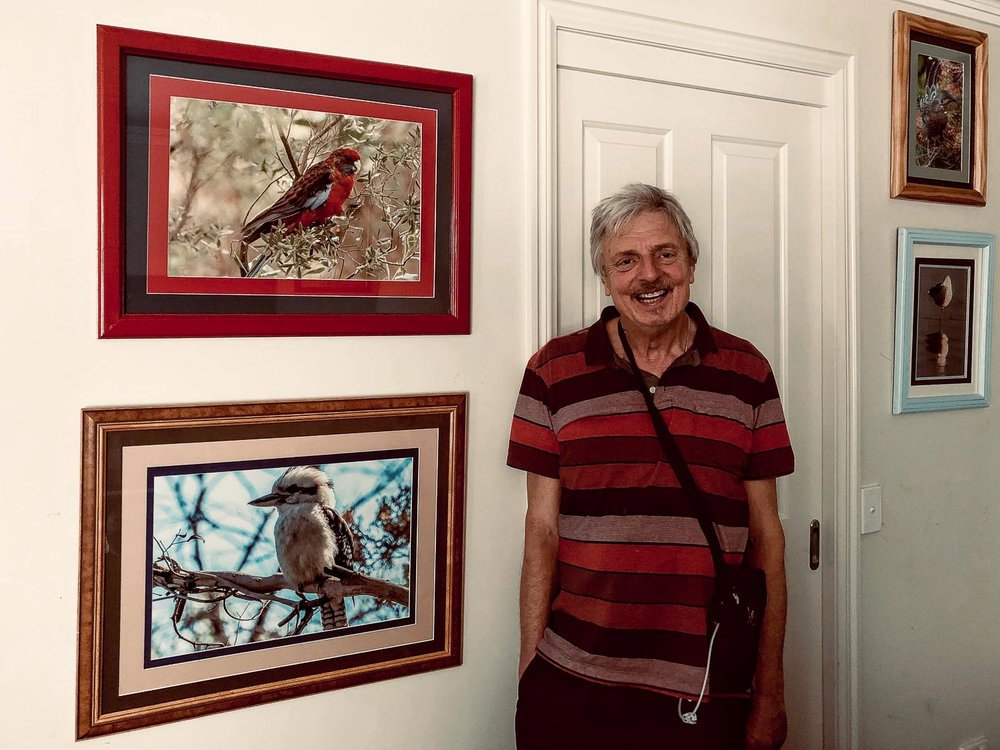 Ralph Holland    at home with some of his framed photos on display.