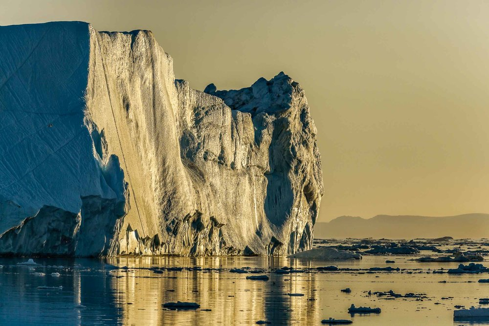 A    giant iceberg    photographed under the    midnight sun    on the    Ilulissat Icefjord    near the town of    Ilulissat    in    Western Greenland   .