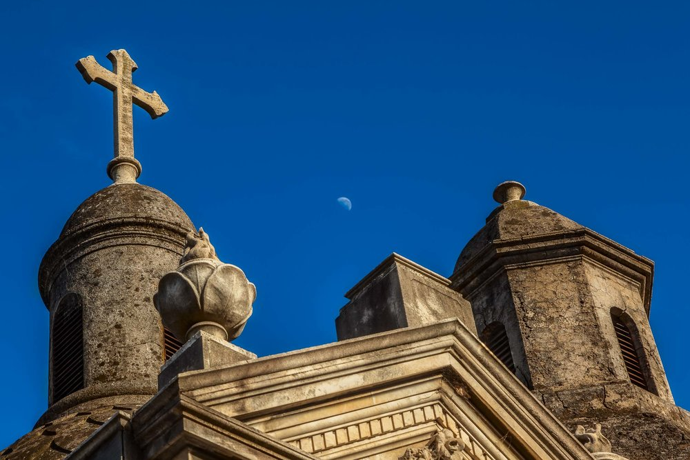 A    Christian cross    and a moon dominate this colorful image from the    La Recoleta Cemetery    in    Buenos Aires, Argentina   .