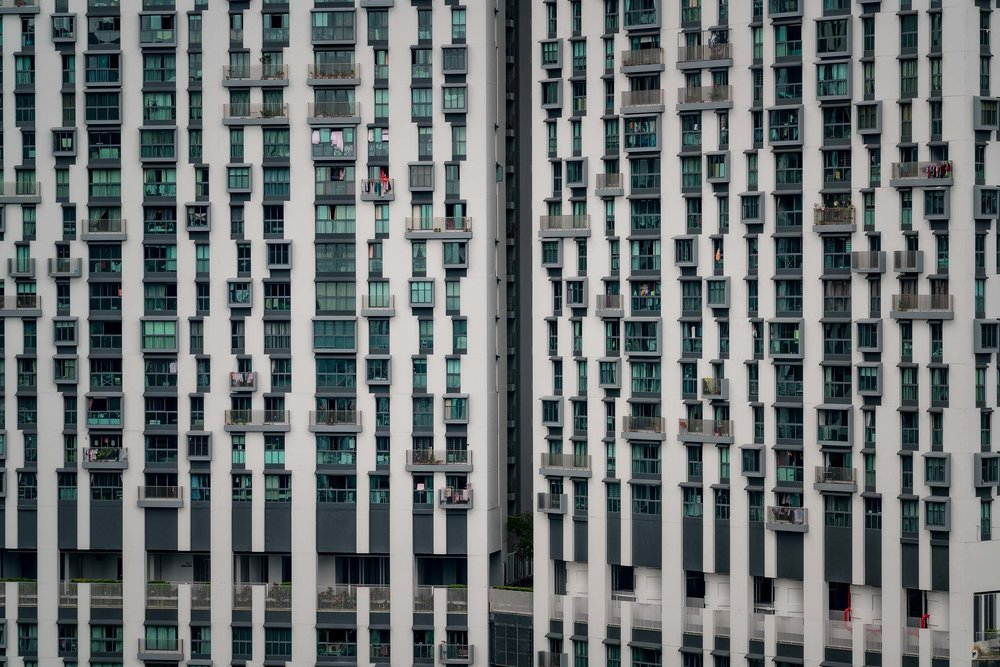 Design prinicples of    symmetry and repetition    explored in this photo of a    high-rise apartment block    in    Singapore   .