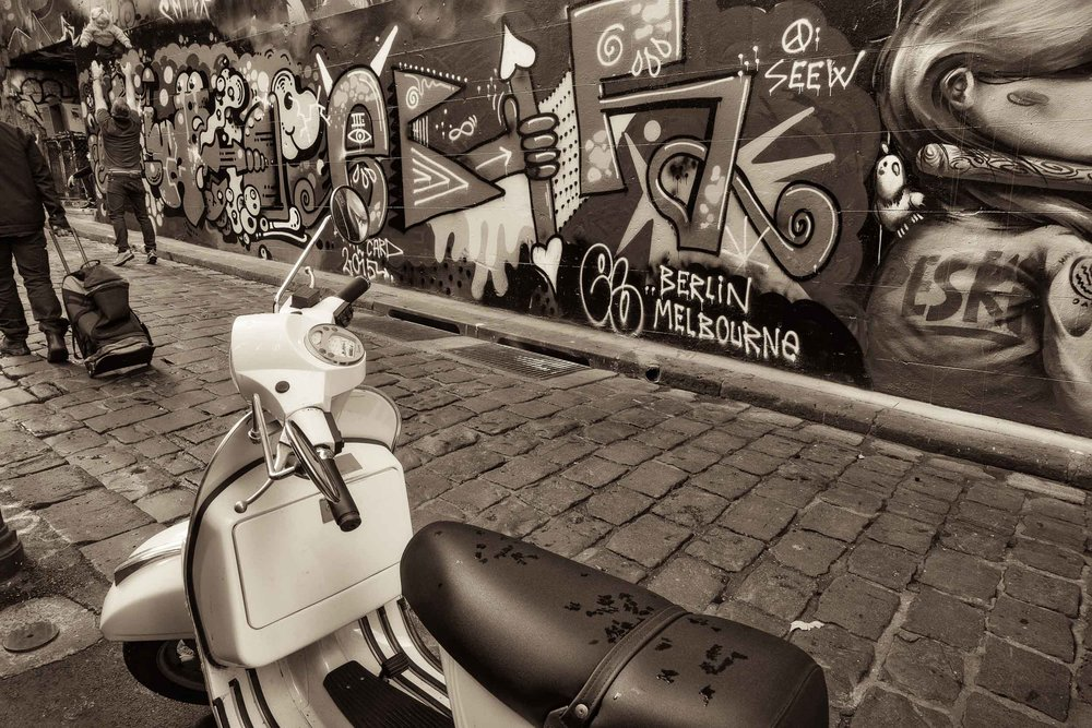 Three    different modes of travel    explored in the iconic    Hosier Lane    in    Melbourne, Australia   .