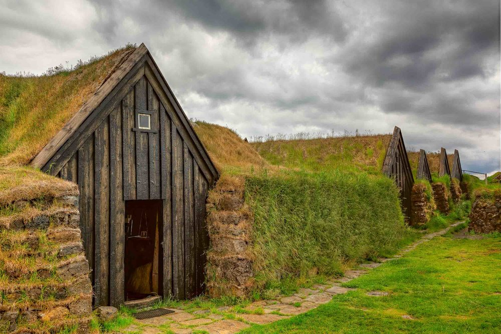 A series of well preserved,    grass topped    traditional    farm buidlings    in    southern Iceland   .