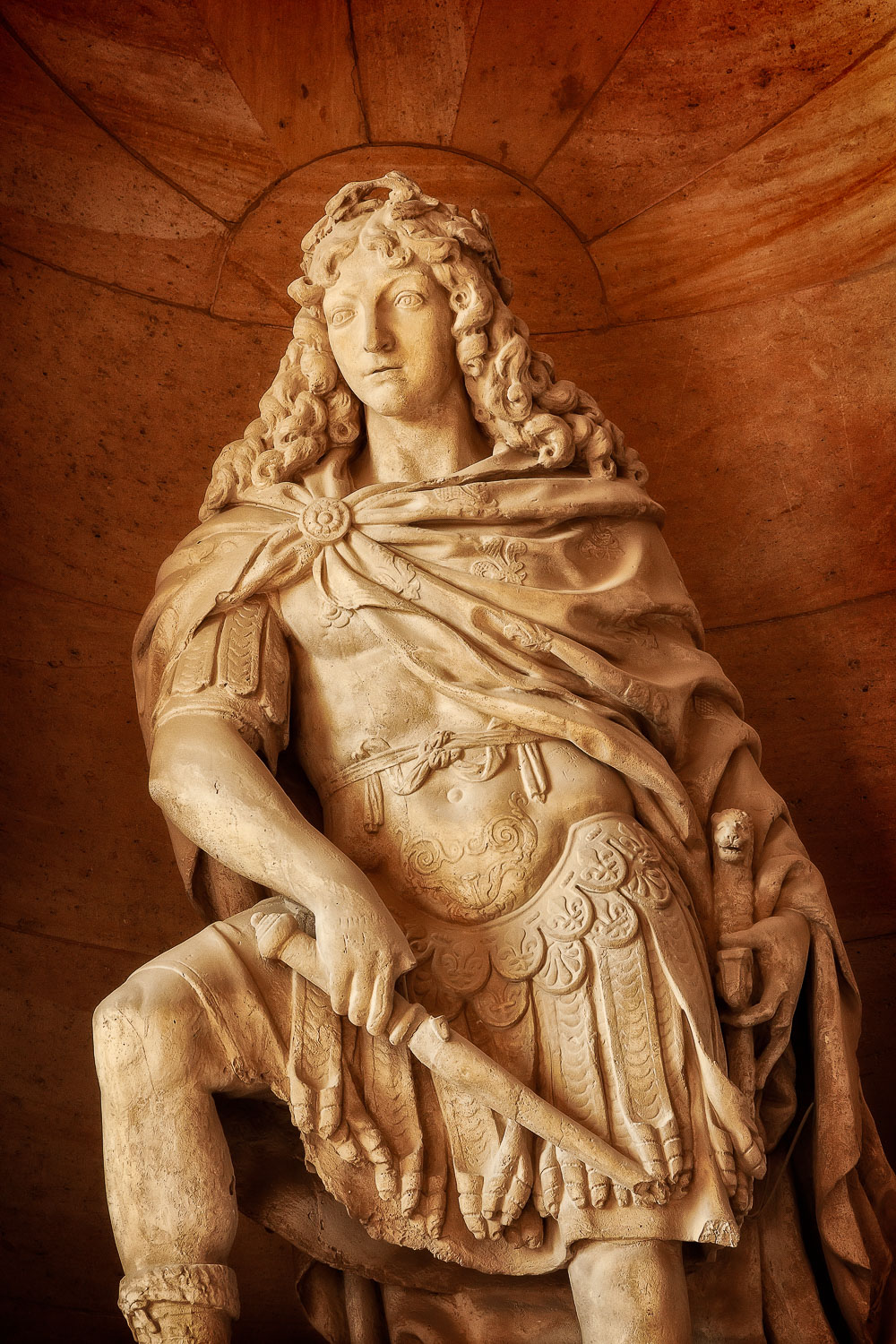 A statue depicting    King Louis XIV   , the    Sun King   , at the    Palace of Versailles   , France.