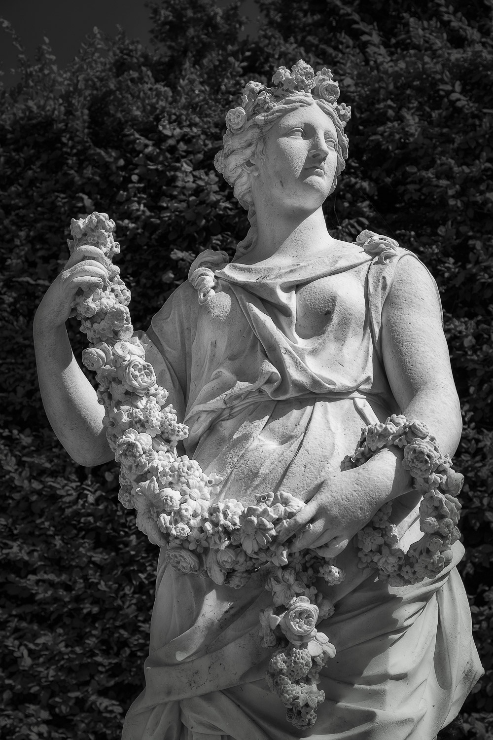 Statue and wreath    in the grounds of the    Palace of Versailles   , France.