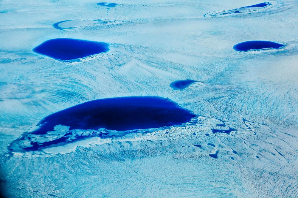 A huge region of    ice and water    photographed from a plane over    Southern Greenland    on the way to the tourist town of    Ilulissat    on the West coast.
