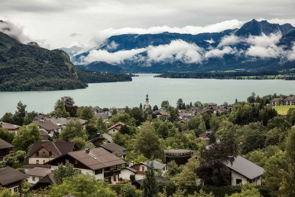 The beautiful village of    St Gilgen    backed by low lying clouds above    Lake Wolfgang    near Salzburg, Austria.