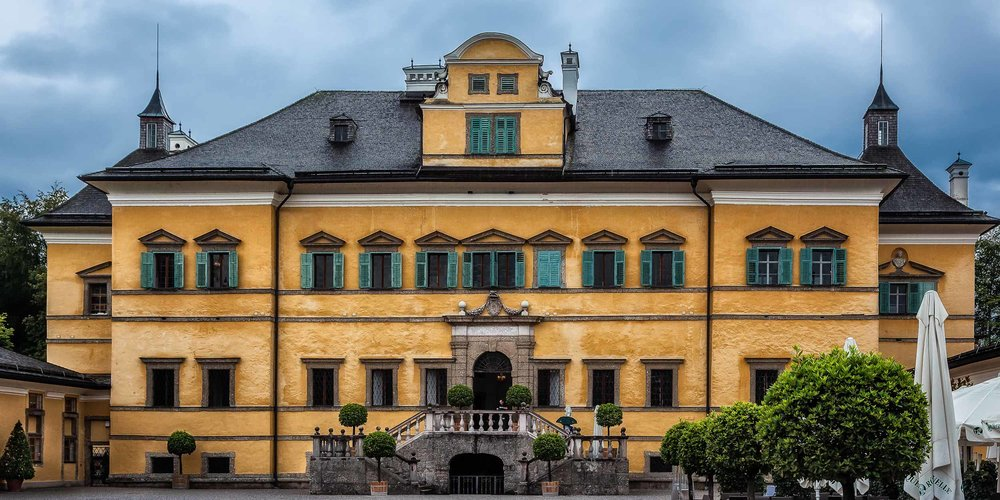 The butter yellow exterior of    Hellbrunn Palace    in    Salzburg, Austria   . The    Gazebo    from the    Sound Of Music    film is now located in the palace grounds.