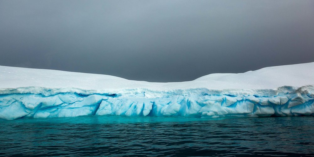 Color and texture    dominate in this    panoramic view    of a large iceberg in    Paradise Harbour, Antarctica   .