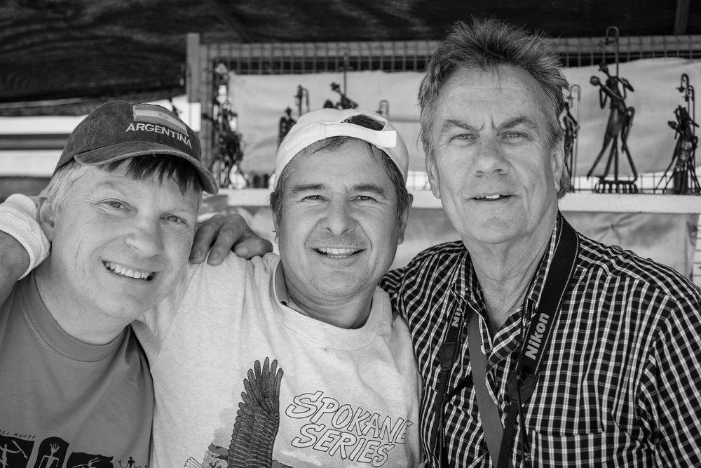 Glenn Guy   , the    Travel Photography Guru   , with a local retailer and Col Pearson, a participant in a photography tour Glenn co-ran at a market in    Buenos Aires, Argentina   . Photographer Unknown.