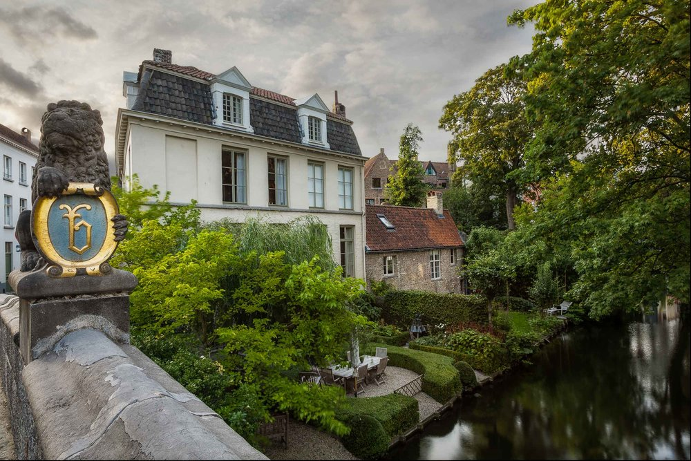 Houses    by the    canal    in the beautiful city of    Bruges, Belgium   .