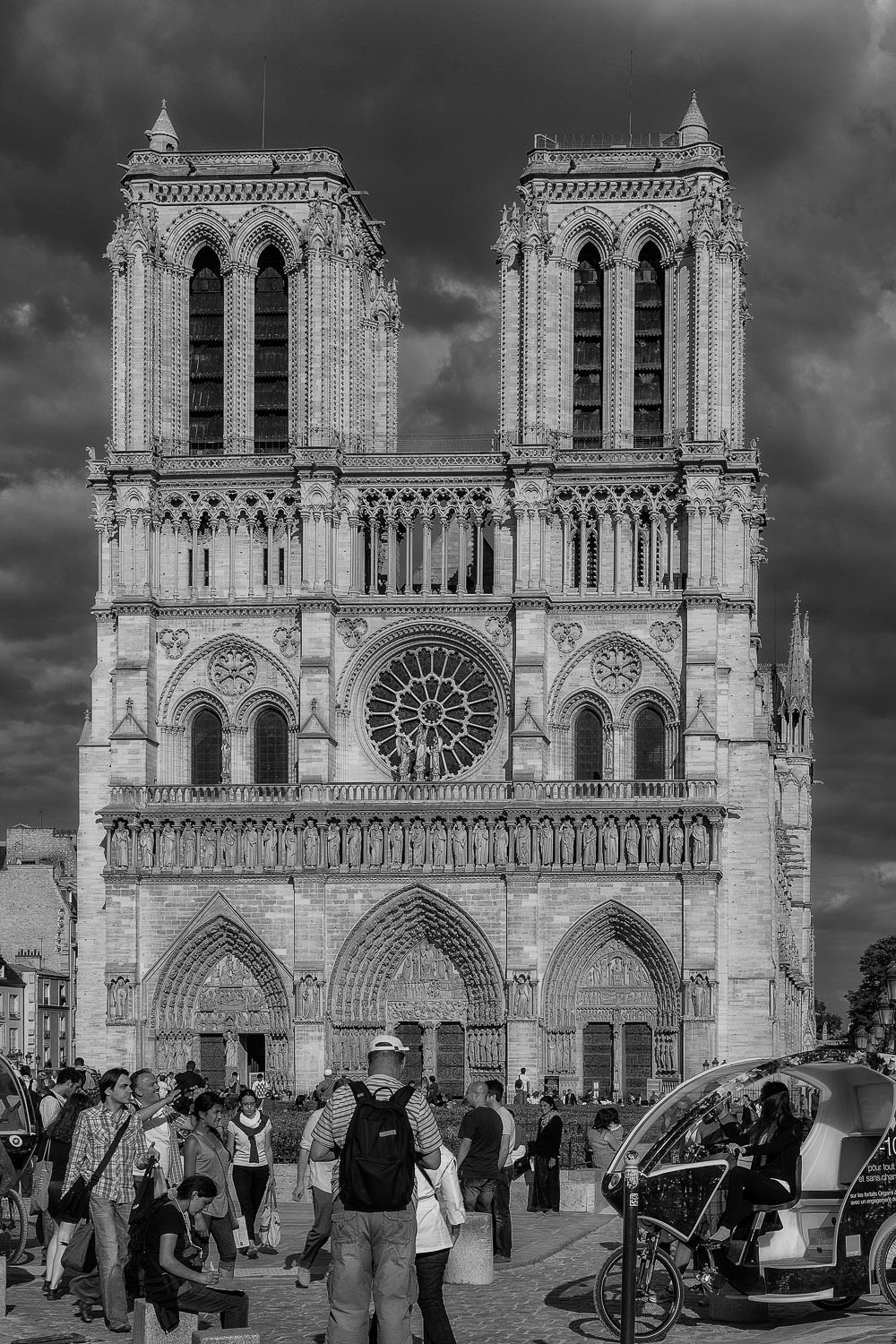 Tourists    outside the spectacular    Notre Dame Cathedral    in Paris,    France   .