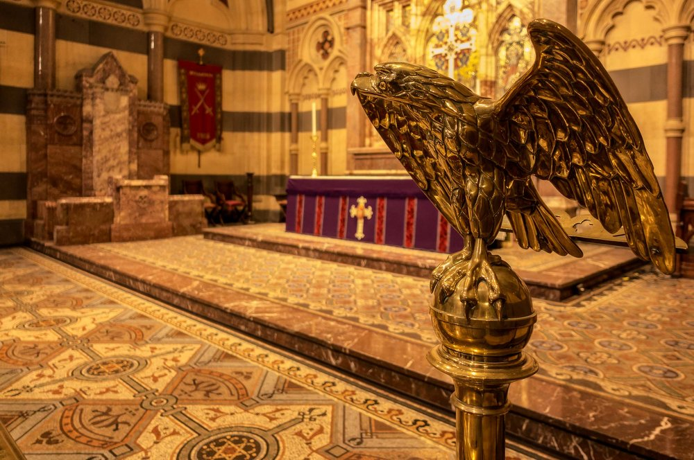 A brass lectern, featuring an    eagle on a sphere   , on the altar at    St. Paul's Cathedral    in    Melbourne   , Australia.