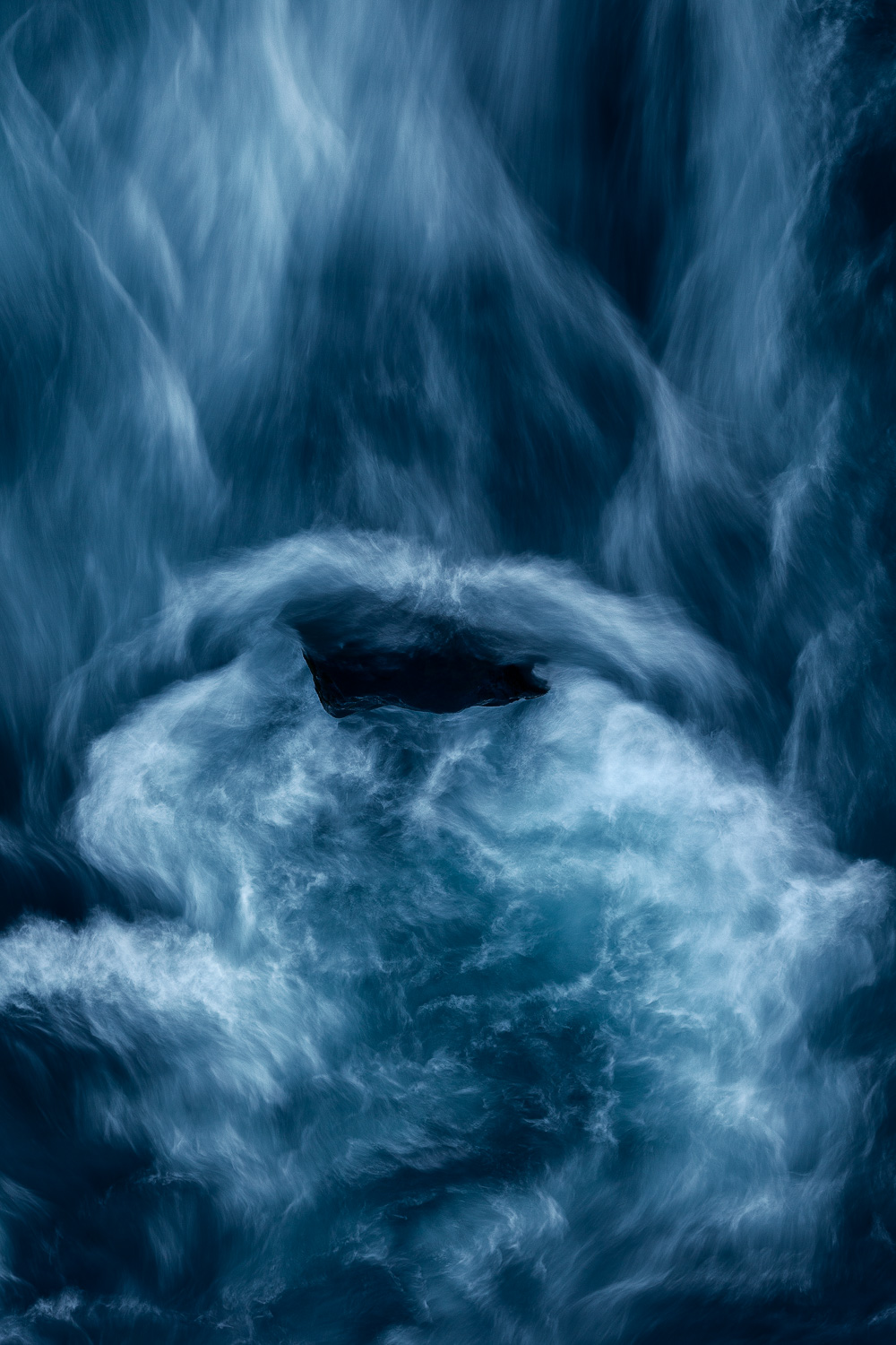 An    abstract detail    of a    waterfall   , under evening light, in    Iceland   .