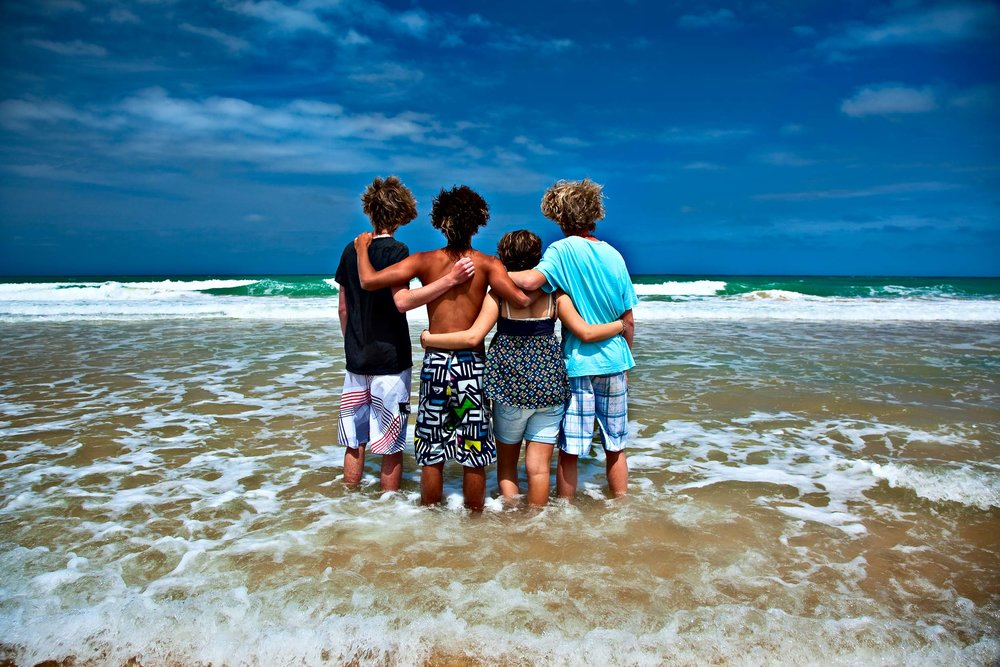 Local    Sale    band,    Saida   , looking towards a bright future from the beach at    Seaspray, Australia   .