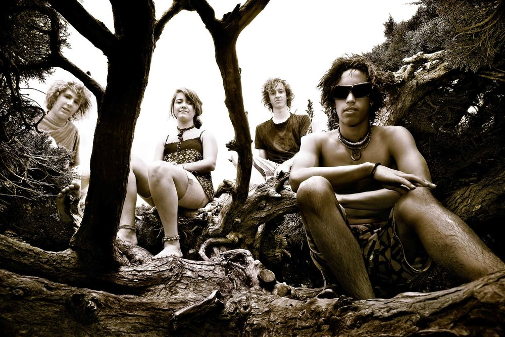 Four friends    from the Sale based band,    Saida   , in a park by the beach at    Seaspray, Australia   .