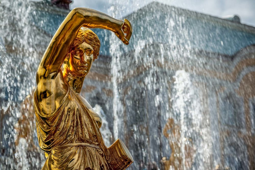 Statue on the edge of the fountain at  Peterhof Palace  near  St. Petersburg, Russia