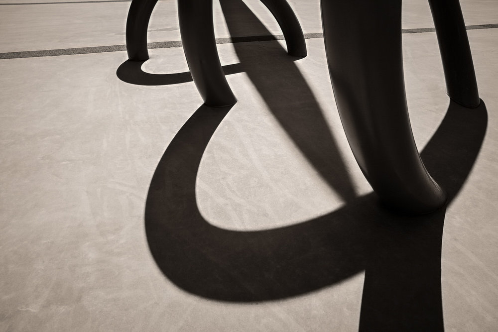 A detail of an    architectural element,    in silhouette, outside Etihad Stadium in Melbourne, Australia. This photo incorporates elements of composition including line, shape, light, shadow and texture.