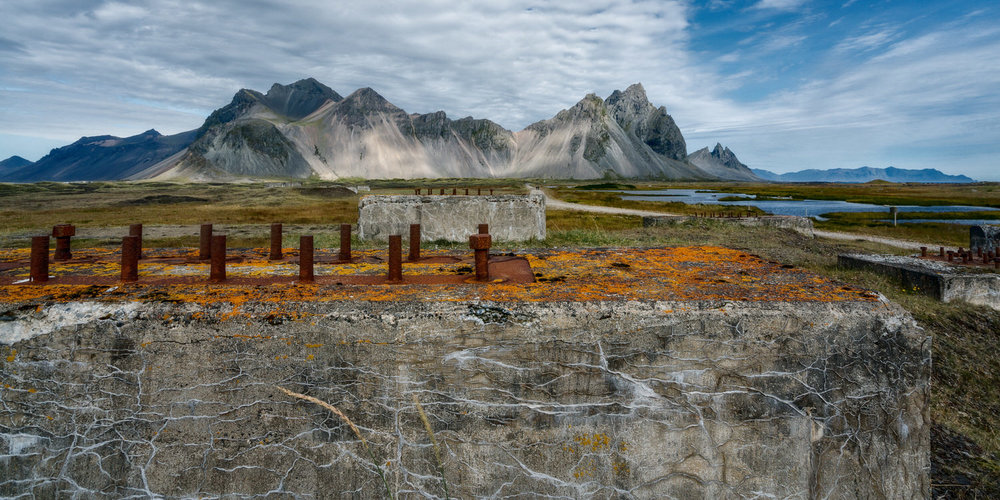 Ruins of structures past lie in an evocative landscape location near    Höfn    in    Southern Iceland   .
