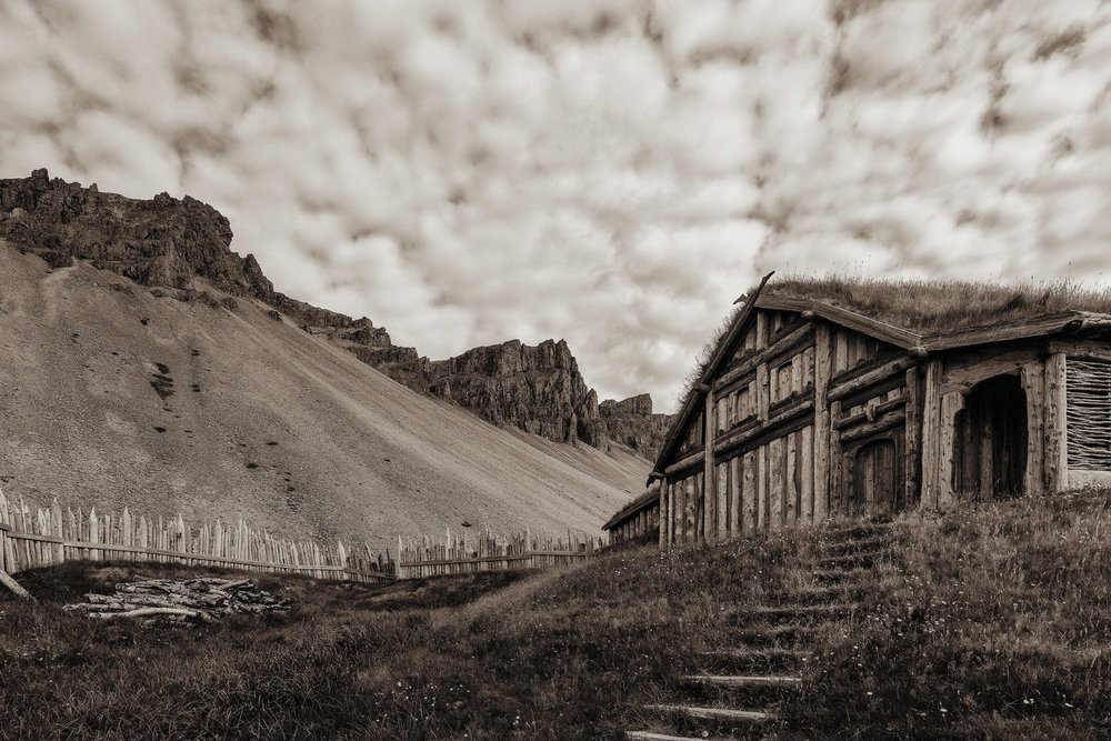 An evocative photo of a replica of a    Viking village   , constructed as a film set, in a dramatic setting near    Höfn    in rural    Iceland   .