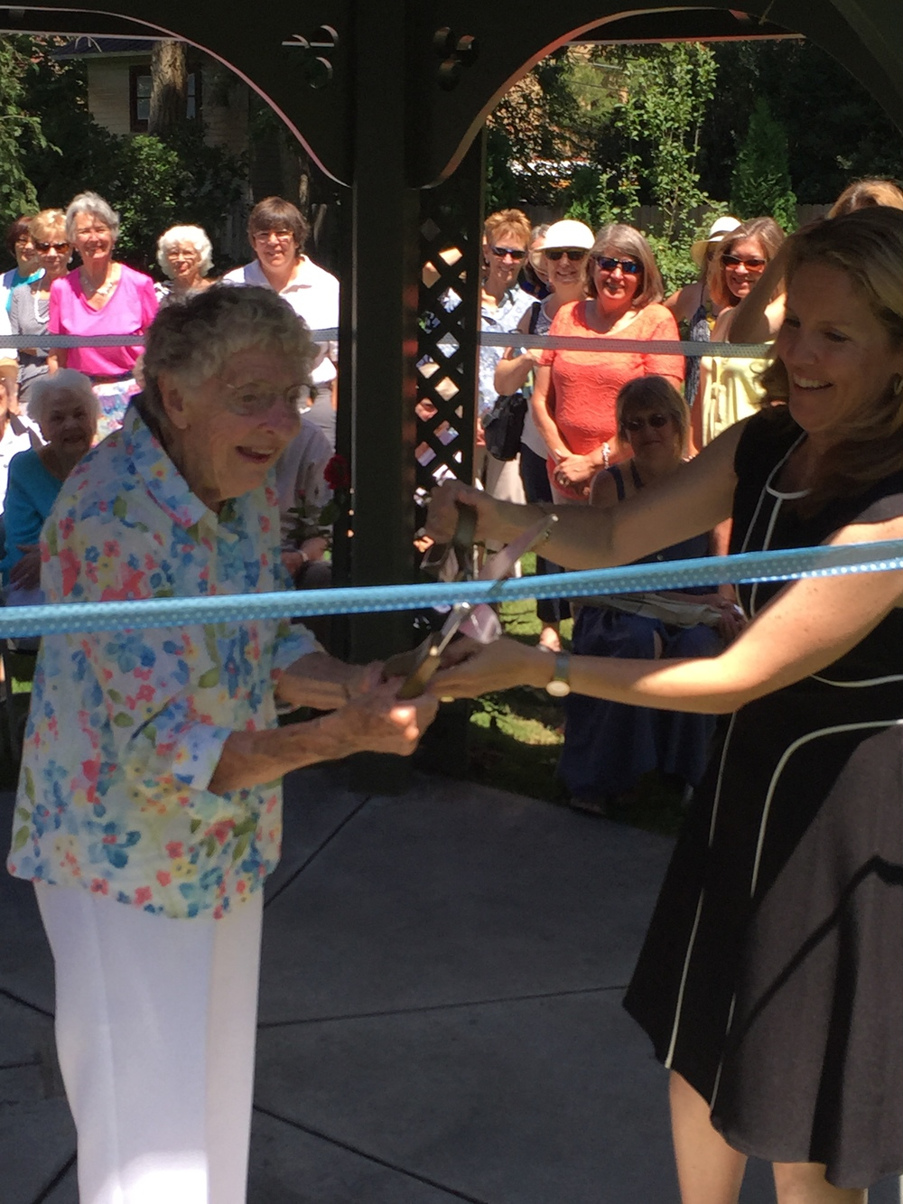 "Margareth's  dear friend and PLF ""teammate"" Ethel Ashley (left) cuts the ribbon at the gazebo dedication ceremony"