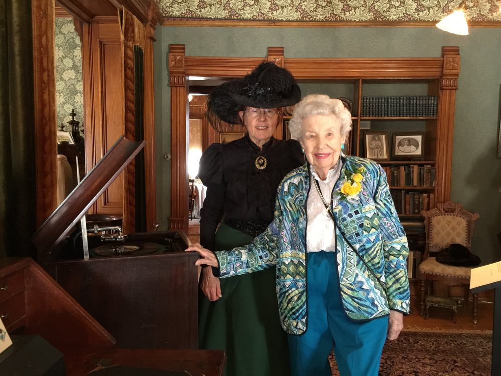 Avery House docent Karol Harding (l.) poses with Margaret Brown (r.) during Margaret's tour of the Margaret Brown Collection exhibit at the Avery House.