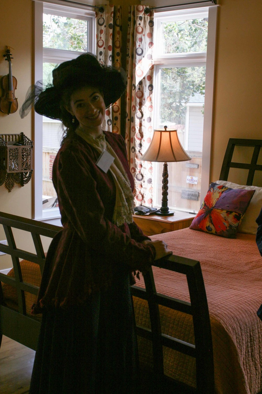 A volunteer docent is stationed at a historic home on Smith Street
