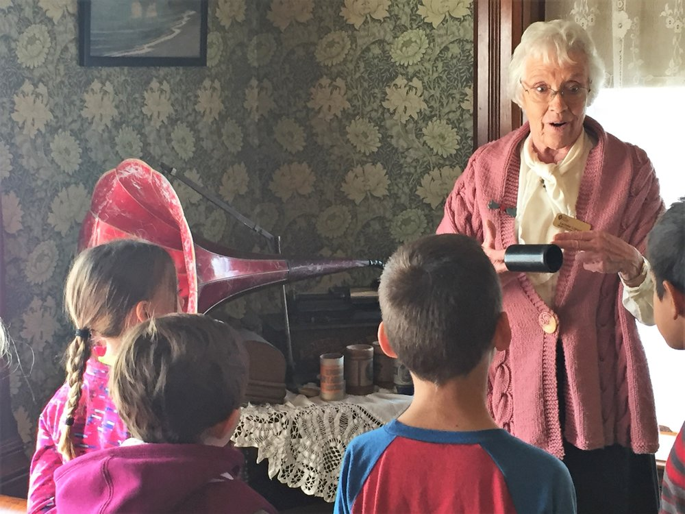 2nd graders tour the avery house, led by retired teacher and longtime volunteer lynda lloyd