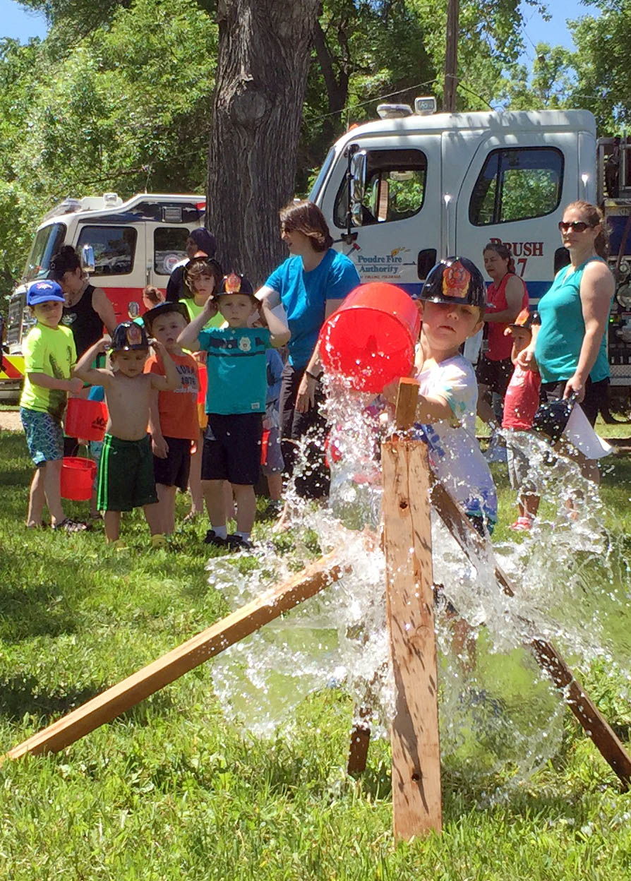 Poudre fire authority demonstrates the fire hose at the big splash
