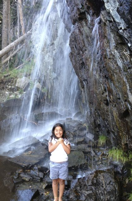 Adorable girl in front of a waterfall at TSV