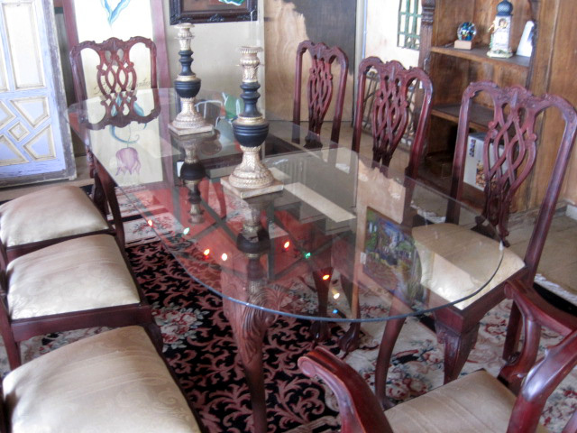Oval glass-topped, oak base dining or sidetable