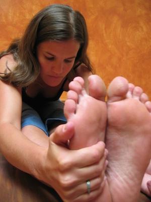 An unedited picture of my Flintstone feet in paschimottanasana.