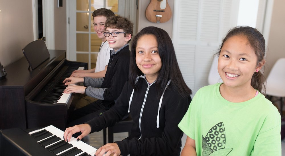 teen group playing piano