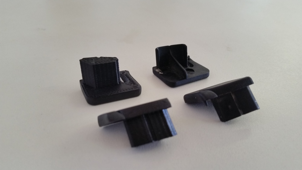 The final 3D printed part on the left vs. the OEM plastic end caps on the right.