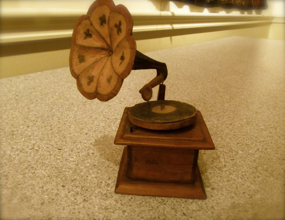 One of Lula's brother's, Willy, made this woodcarving of a phonograph for his school teacher in Jefferson when he was 17 years old in 1912. His school teacher happened to be the mother of the genealogist who was helping Ed to research his family. She had treasured the carving for many years, and now Ed treasures it.