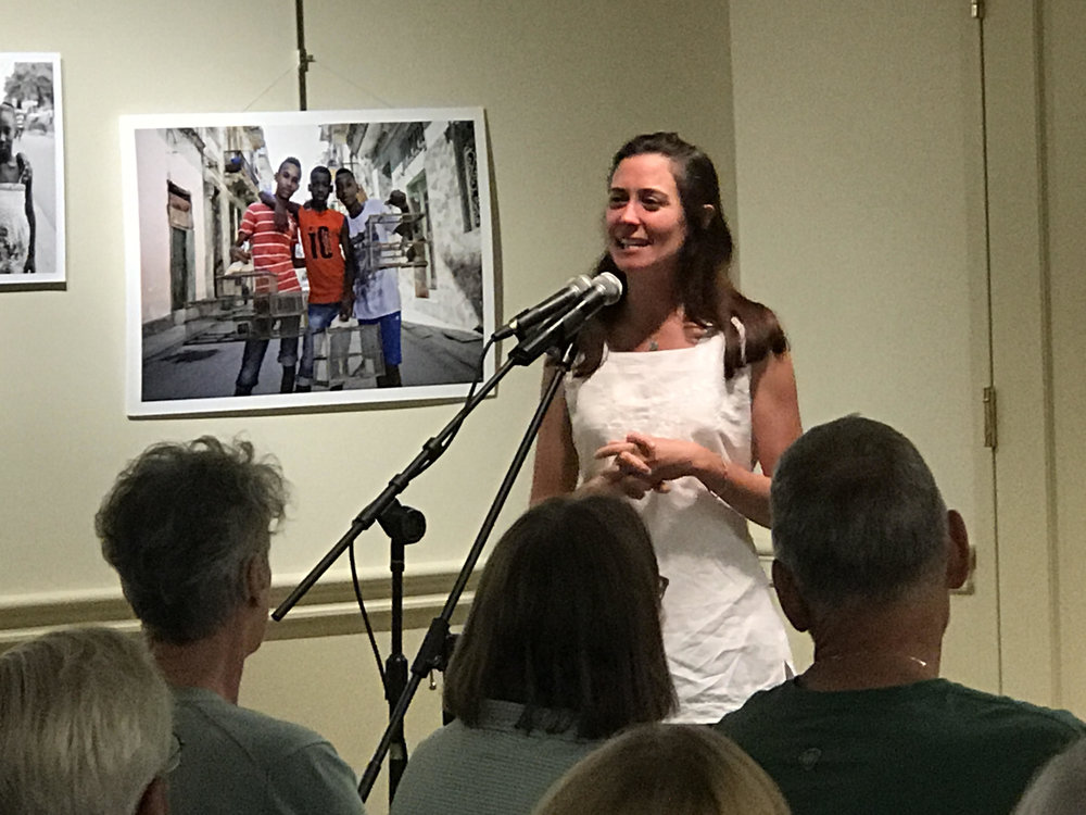 Meghan telling a story at the Midcoast Women's Collective Voices event. June 2017.