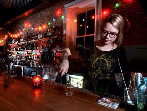 Bartender Amber Yates pours a glass of whiskey at the Silver Dollar Photo by: Thomas Wavid Johns