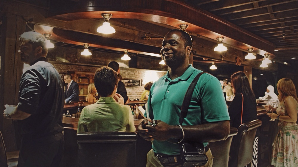 Explore Kentucky founder Gerry James enjoying the Evan Williams Experience's Speakeasy Bar