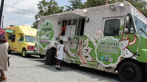 Food trucks serve patrons in northern Atlanta. Photo by Jessica Hunt. American City & County.