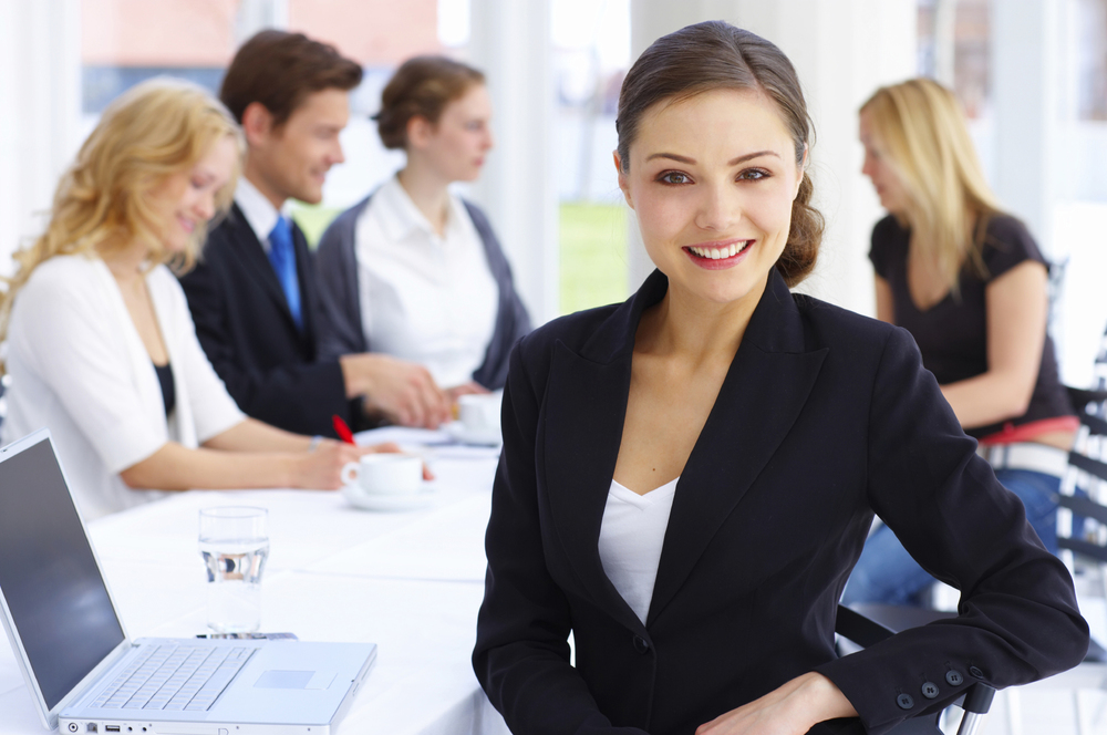 business-woman-table-group.jpg