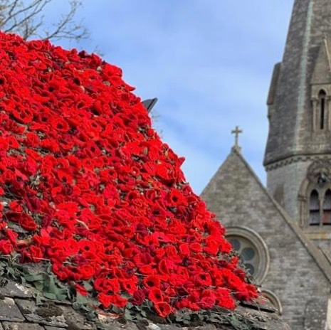 """POPPY    """"In war, there are no unwounded soldiers"""". - This beautiful church was captured locally in Ramsden church. - I love harmony between creative garden design and architecture. - #susandunstall #lestweforget -"""