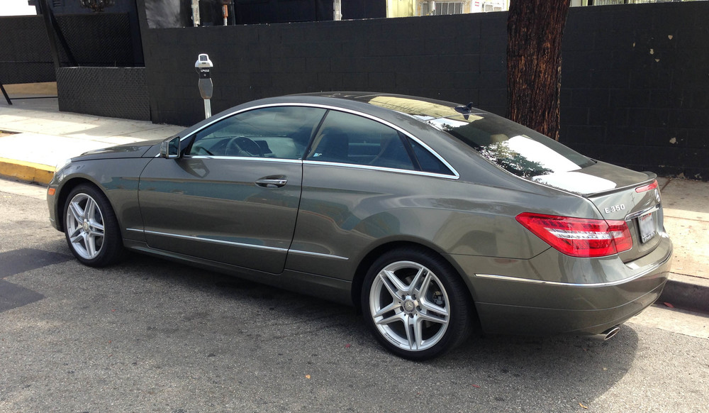 An Olivine Green Mercedes E350 Coupe