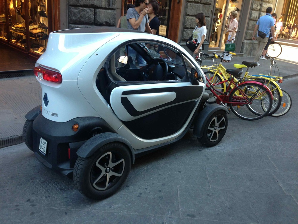 "Renault Twizy, which offers a ""1+1"" seating layout for the driver and a (very small) passenger behind, in Florence, Italy (Photo: The Car Crush)"