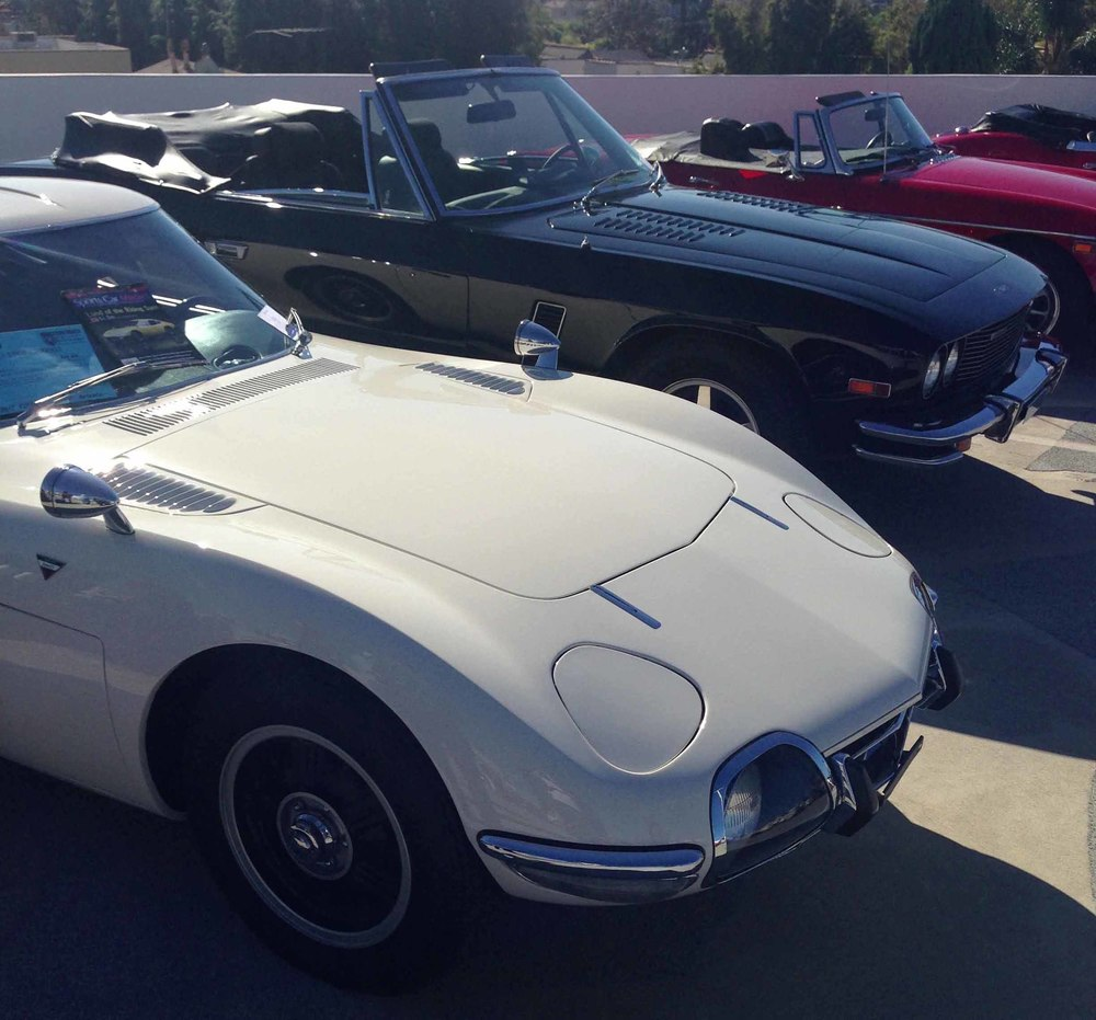 1967 Toyota 2000GT (white), and 1976 Jensen Interceptor Series III Convertible