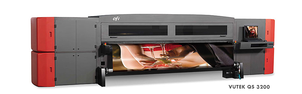 - Six-color printing for outstanding clarity. (C, M, Y, K, LC, LM) - High Definition, 1080 dpi printing. - Additional white print capability allows printing white in six variations (overprint, underprint, spot, underspot, fill, overspot). - Changeover to print on flexible and rigid substrates in less than one minute. - Eliminates mounting and lamination of flexible materials for rigid application. - Prints quality output up to 900 sq. ft./hour (84 sqm/hour) — twenty-two 4' x 8' sheets per hour. - Robust, production design for around the clock operation.