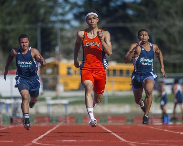 Lakes' Isaac Swillie, center, runs the 100 meters to win in an official time of 10.75 seconds in a track meet against Auburn Riverside on Thursday. Swillie also won in the 200 meters (21.37), long jump (22 feet, 7 inches) and was part of the winning 1,600 relay team (3:39.39)