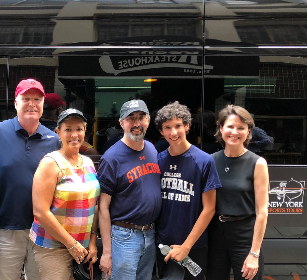 Tour guests from Long Island and Chicago pause outside Keens Steakhouse with New York Sports Tours' Kathy Paprocki (right)