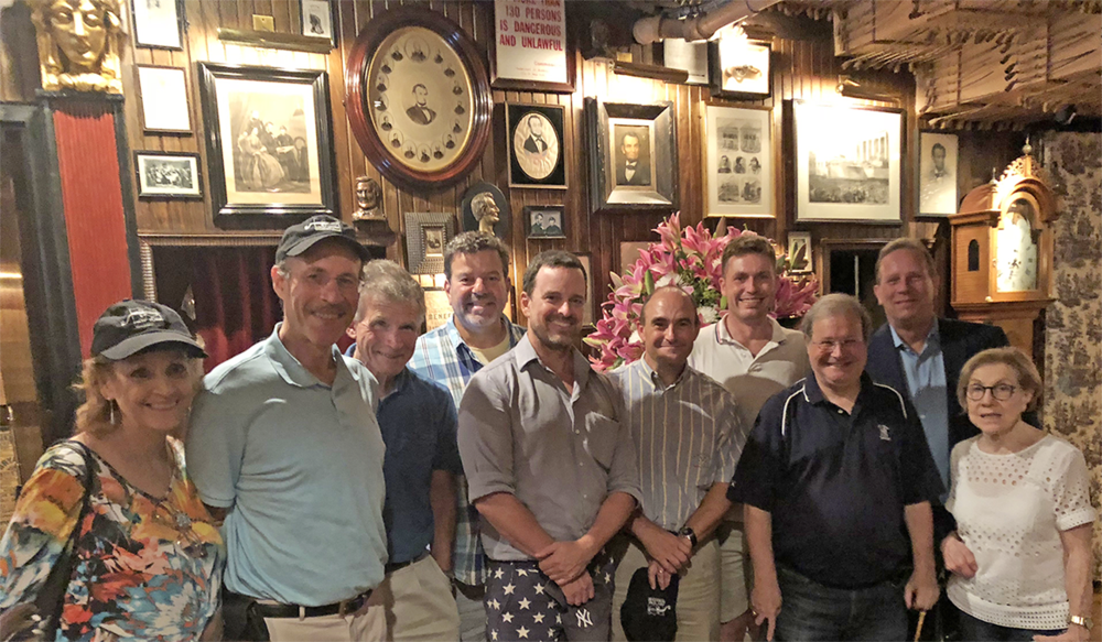 Marty Appel (third from right) pauses with tour guests in Keens' famed Lincoln Room following a post-tour dinner he hosted.