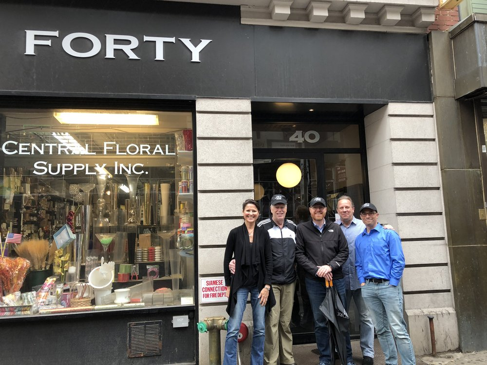 New York Sports Tours' Kathy Paprocki and Kevin O'Keefe (sans hats) stop with guests from Atlanta, San Francisco and New York at a Tin Pan Alley building where the 1908 song Take Me Out to the Ball Game came to life
