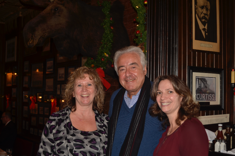 Legendary New York sports broadcaster Sal Marchiano with two tour guests in Keens' Bull Moose Room, a room inspired by former Keens patron Theodore Roosevelt. Each guest at the post-tour dinner Marchiano co-hosted received a copy of Marchiano's book  In My Rear View Mirror.