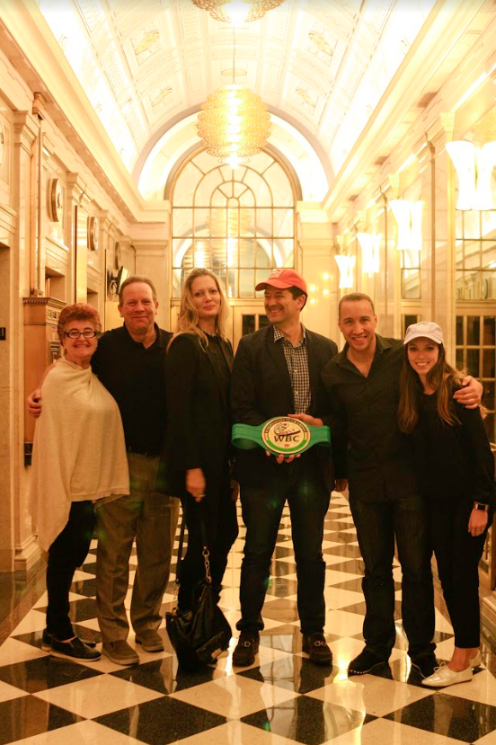 World Boxing Council international champion Boyd Melson (second from right) shares his championship belt at a tour stop